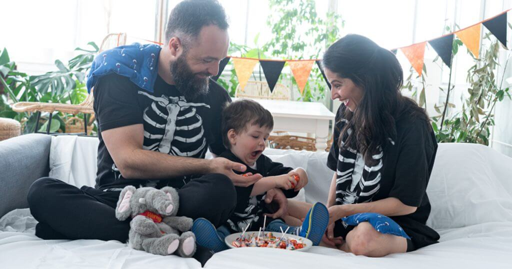 family in halloween costumes with Magic Bag