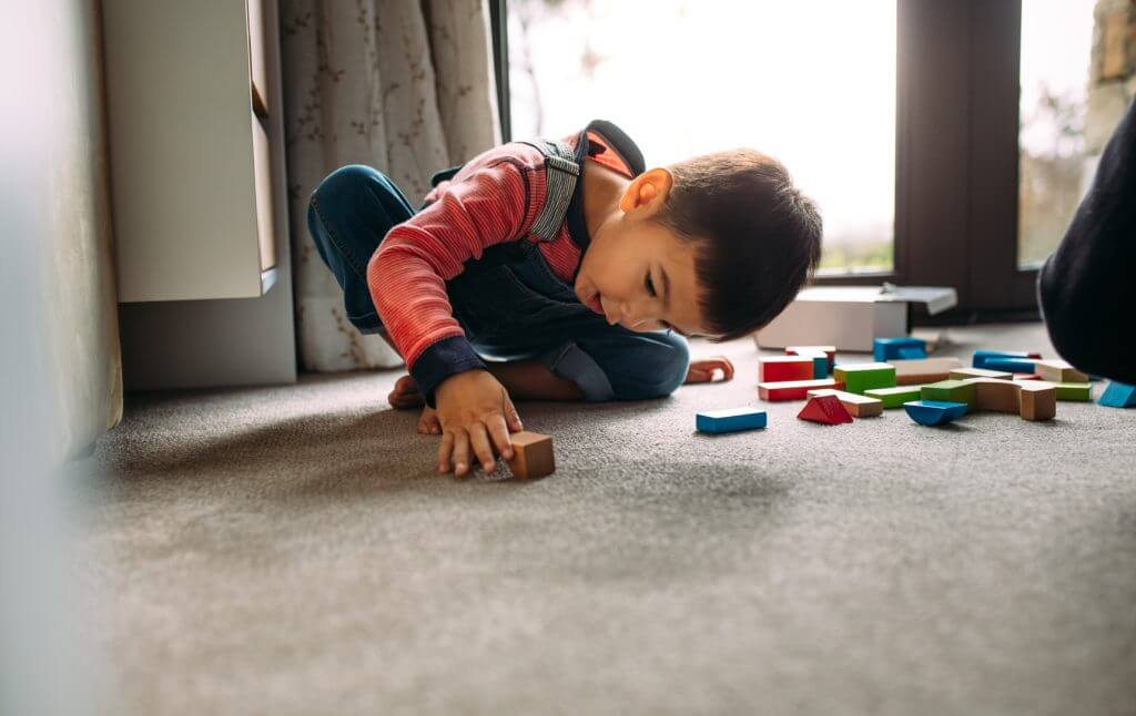 a child plays alone to practice separation from parents and socialization